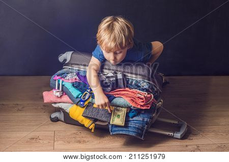 Baby Boy And Travel Suitcase. Kid And Luggage Packed For Vacation Full Of Clothes, Child And Family