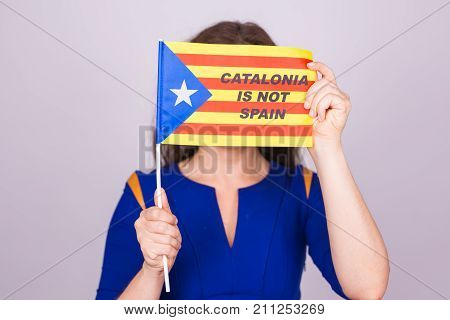 Portrait Of A serious catalan woman with estelada flag. Referendum For The Separation Of Catalonia From Spain. Democracy Independence Concept