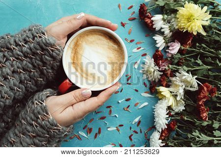 warm and comfy concept. Hot cocoa coffee cappuccino on a cold autumn day. Knit wool concept