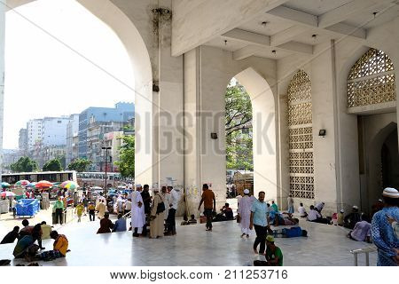 Dhaka, bangladesh- October 2017: people sitting at outside of Baitul Mukarram National Mosque in Dhaka, ocated at baitulmukaram area in Bangladesh taken at 24th October, 2017