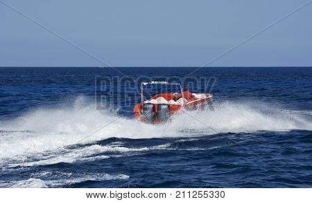 Motor boat in the sea. Running motor boat with water surface behind of fast moving. Fast moving motor boat. Security service in the sea