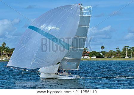 Children Sailing in High School Sailing Championships. Belmont Lake Macquarie New South Wales Australia.