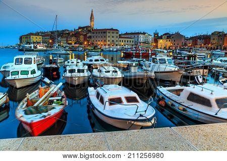 Beautiful windy morning with fishing boats in the harbor, Rovinj, Istrian Peninsula, Croatia, Europe