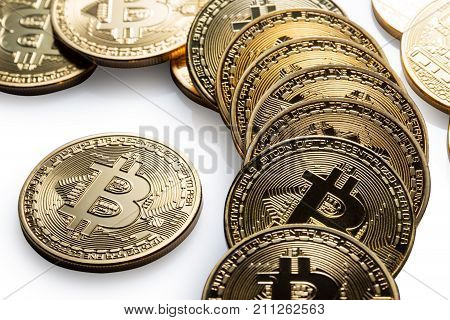 Scattered crypto currency golden bitcoin isolated on white background. The concept of virtual international currency and business on the Internet.