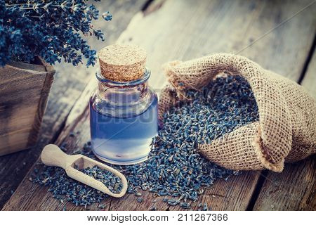 Lavender Essential Oil Or Infusion, Hessian Bag Of Dry Lavender And Wooden Box Of Dried Flowers.
