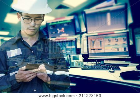 Double exposure of Engineer or Technician man in working shirt working with smart phone in control room of oil and gas platform or plant industrial for monitor process business and industry concept.