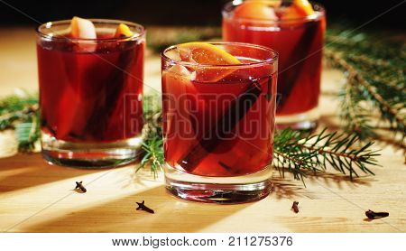 Hot wine drink. Warm Christmas wine. Mulled wine with oranges