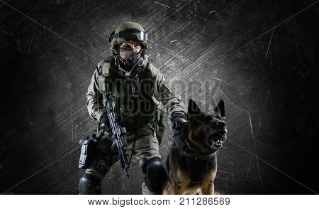 Military Man In Uniform With A Weapon In His Hands Sets The Sheepdog On A Criminal.