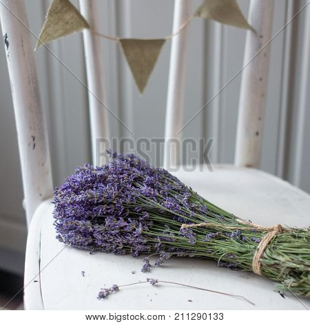 bouquet of lavender on vintage wood with old blank tag gift