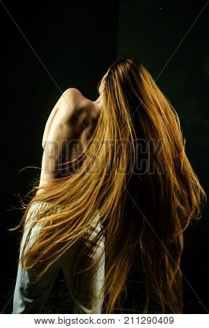 Girl Has No Makeup And Healthy Hair On Black Background.