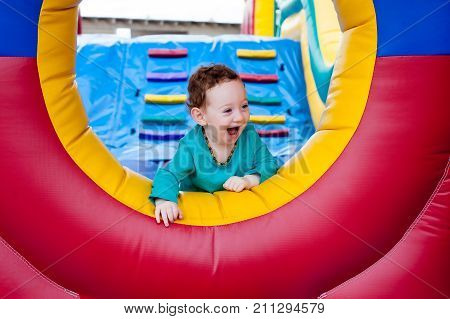 Happy Toddler Peeking On Trampoline