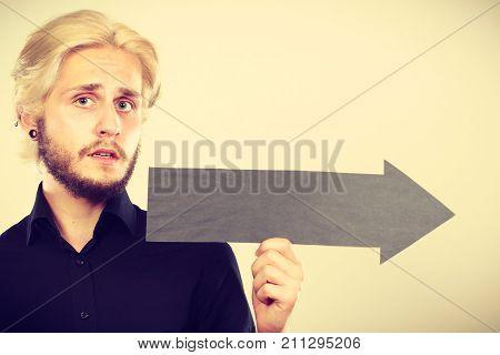 Man Holding Black Arrow Pointing Right