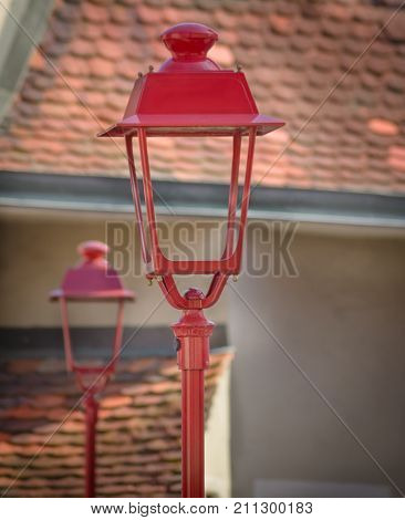 Streetlight against the background of old roofs