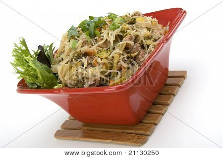 Pancit in a Red Ceramic dish with Garnish. poster