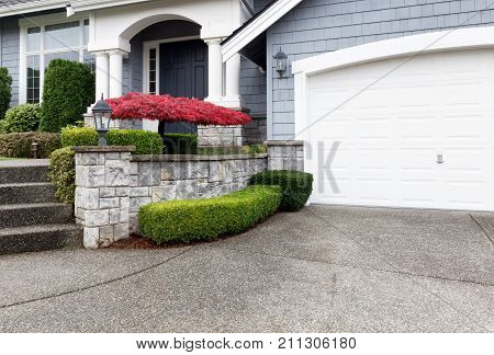 Beautiful home exterior with Autumn color maple tree