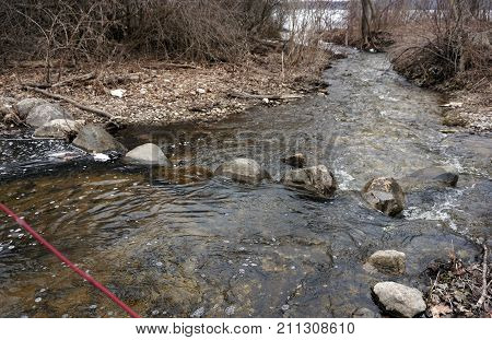 Tannery Creek flows toward Little Traverse Bay near Bay View, Michigan, during March.