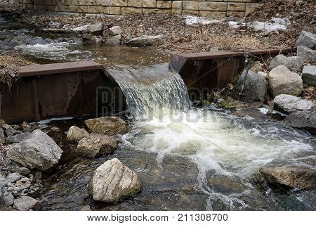 Tannery Creek flows over a small dam before emptying into Little Traverse Bay near Bay View, Michigan, during March.