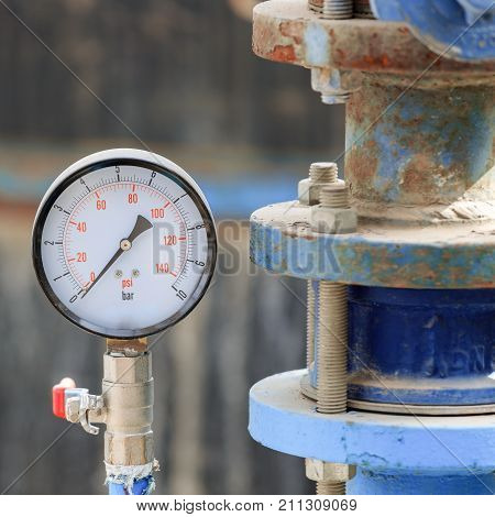 Manometer Near Old Blue Pipe