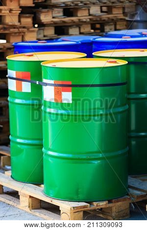Green Barrels With Red Label Poison On Wooden Pallets