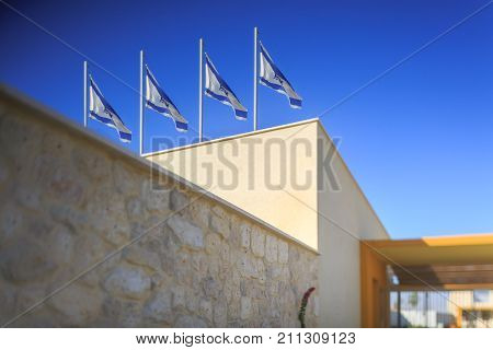 Four flags of Israel on building in wind