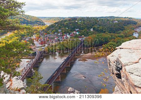 Aerial view on Harpers Ferry historic town and railroad in autumn. Harpers Ferry National Historical Park in West Virginia USA.
