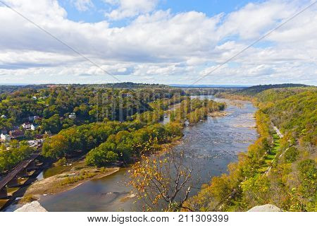 Aerial view on a trail along Potomac River and buildings near Harpers Ferry railway station. Panoramic view on Harpers Ferry National Historic Park in autumn West Virginia USA.