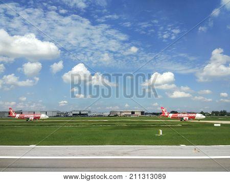 Bangkok,Thailand-October 19:Air Asia Airplane in Don Mueng Airport ,Plane parked airport ,October 19,2017 in Bangkok,Thailand.