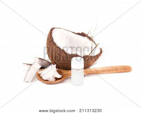 Half of coconut, pieces of coconut, coconut flakes and coconut milk, isolated on white background.
