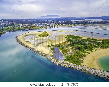 Aerial view of Narooma inlet - residential buildings shallow water. NSW Australia