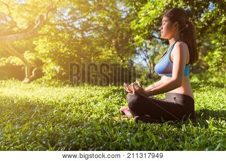 Yoga in the park outdoor with effect light health woman Yoga woman. Concept of healthy lifestyle and relaxation. yoga vintage. yoga in park. girl yoga relex. yoga fitness. yoga concept. yoga woman. yoga body. yoga relax. yoga girl. yoga female.