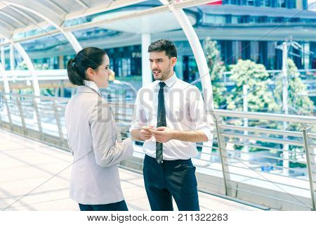 Businessman ask for advice from woman colleagues young male and female entrepreneurs working together concept of business negotiation and deal benefit.