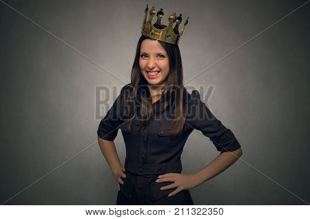 Angry and disgruntled woman boss with golden crown above her head. Angry and smug client concept. poster