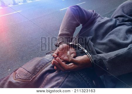 Man in handcuffs on the street at night