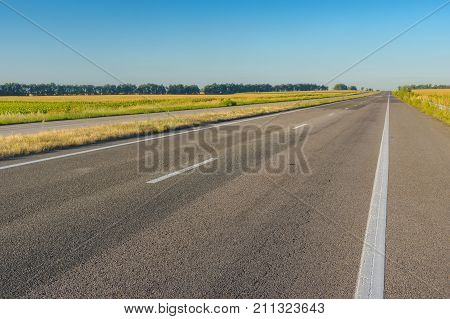 Morning landscape with empty high-way Dnipro-Kharkiv in central Ukraine