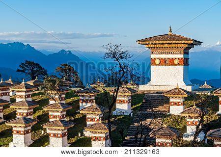 Sunset on Dochula Pass with Himalaya in background - Bhutan. In this pass, 108 memorial chortens or stupas known as Druk Wangyal Chortens have been built by Ashi Dorji Wangmo Wangchuk.