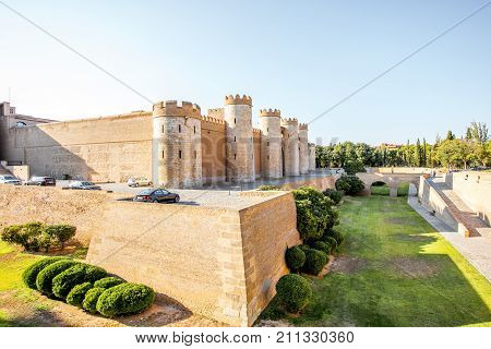 ZARAGOZA, SPAIN - August 20, 2017: View on the Aljaferia Palace during the sunset, fortified medieval Islamic palace built the 11th century in Zaragoza, Spain