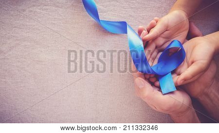 Adult And Child Hands Holding Blue Ribbon, Colon Cancer, Colorectal Cancer, Child Abuse Awareness, W