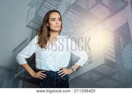 Successful leader. Serious nice attractive woman thinking about her work and looking for a solution of a problem while being a leader