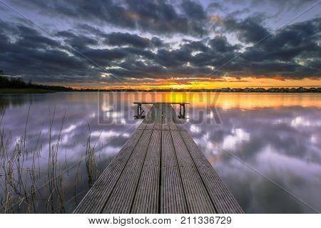 Conceptual Mood Concept Colorful Sunset over lake