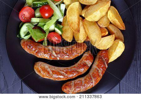 Grilled Sausages, Baked Potatoes, Vegetables Salad