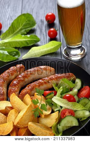 Grilled Bratwurst, Salad, Potatoes And Beer