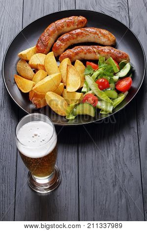 Grilled Sausages, Baked Potatoes And Beer