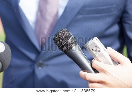 Media interview with business person, politician or spokesman