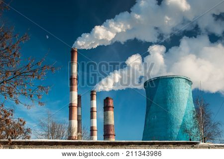 Industrial zone smoke pipes and heat loss winter environmental pollution.