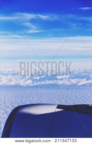 HOBOKEN NJ - September 18th 2017: Clouds and airplane engine seen from the window seat after taking off