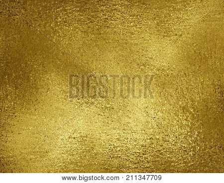 Gold foil texture background. Grunge golden metallic material concept luxury packaging paper leaf. Gold foil background. Golden foil texture.