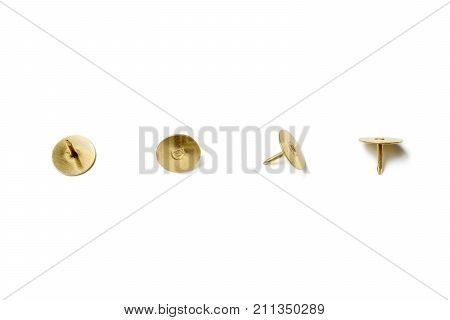 Small Collection Of 4 Brass Thumbtacks Arranged In A Line On White Background