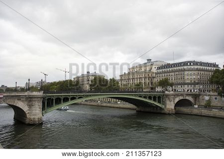 View Landscape Of Paris City At Riverside Of Seine River And Classic Building Of Prefecture De Polic