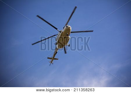 Passenger cargo Russian helicopter flying in the sky.