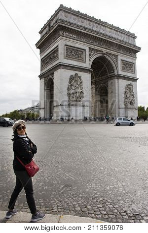 Asian Thai Woman Travlers Posing With Arc De Triomphe De L'etoile Or Triumphal Arch Of The Star At P